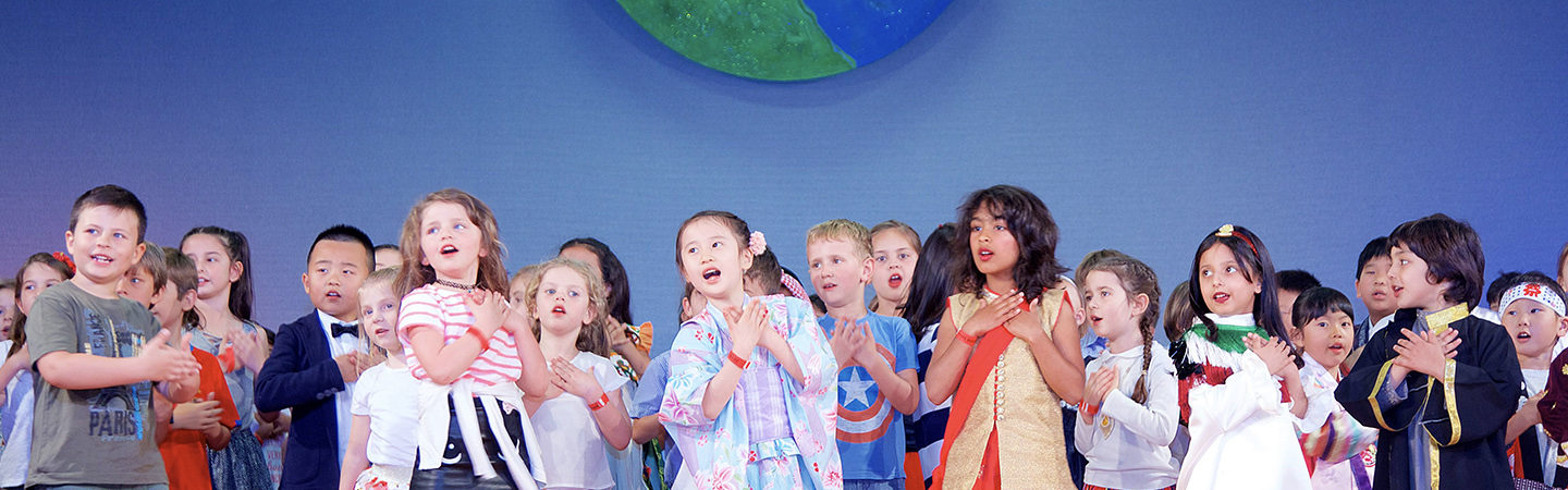 Children singing at the American Schools in Italy International